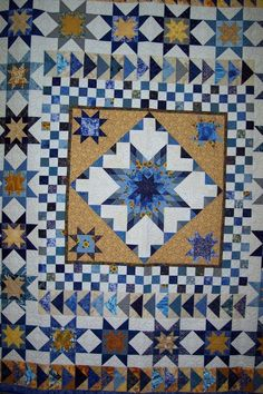 """You've probably heard of Round Robin quilts, where one person makes a starting block and passes it on so someone else can put on the next border.  This goes on for several rounds and then the completed quilt top returns to its originator.  In a Nesting Robin, one person does all the work, but instructions are given monthly for what should be in the next border.    Measuring 86"""" x98""""  this quilt is suitable for either a double or queen size bed."""
