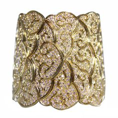 1980's Diamond and Gold Bracelet | From a unique collection of vintage cuff bracelets at http://www.1stdibs.com/jewelry/bracelets/cuff-bracelets/