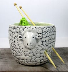 Made to order 1-2 Weeks This quiet sheep yarn bowl is mould with a white low fire casting slip. The mold is designed and made by me. I animated each one adding ears, eyes ,tail Painted with underglaze and glazed with transparent glaze. 5 wide 3 3/4 height Thanks for visiting.
