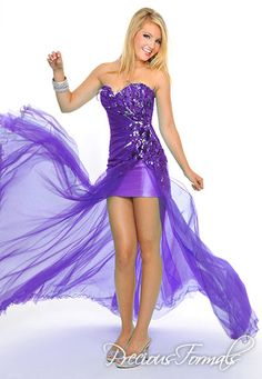 Precious Formals Style P55160 Two tones of illusion pleat out from a waterfall of sequins and feathers and fall down over a short strapless charmuse underdress to the floor.