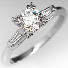 The vintage ring is centered with one old European cut diamond weighing carat set into a four-split prong head. The shoulders of the ring are each accented with one channel set, tapered baguette cut diamonds. The ring measures at the t Estate Engagement Ring, Dream Engagement Rings, Antique Engagement Rings, Merida, Vintage Rings, Vintage Jewelry, Gold Jewelry, Jewelry Box, Antique Diamond Rings