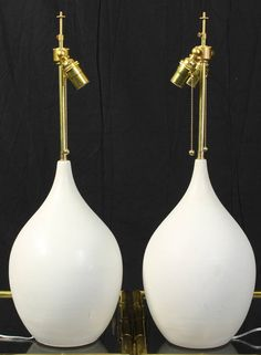 SImple, Sleek. All the editorial power of Black & White. Kaaboom.   Pair of Mid-20th Century Glazed Ceramic Lamps | From a unique collection of antique and modern table lamps at https://www.1stdibs.com/furniture/lighting/table-lamps/
