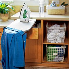 Talk about clever! This compact ironing board unfolds from behind a false drawer front. | Photo: Bob Stefko | More storage ideas @This Old House.com