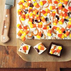 Candy Corn Fudge - (Made with leftover candy - can use any kind) •8 ounce(s) cream cheese, at room temperature •2 cup(s) confectioners' sugar  •2 teaspoon(s) pure vanilla extract  •3 cup(s) white chocolate chips (about 18 oz)  •2 cup(s) mini pretzels or broken pretzel pieces  •1 cup(s) dried cherries  •1 cup(s) candy corn