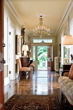 I love a place to sit in a foyer & this chandelier is stunning. This entry hall has doors on both sides, perfect for embracing those hot summer days! - Traditional Home® Design Entrée, House Design, Design Ideas, Beautiful Interiors, Beautiful Homes, Simply Beautiful, House Beautiful, Greek Revival Home, Appartement Design