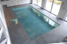 Here's a truly glamorous idea for a pool. A sinking pool! The apparently permanent stone floor in this room literally slowly drops to reveal the pool Luxury Swimming Pools, Luxury Pools, Indoor Swimming Pools, Mini Piscina, Hidden Pool, Pool Installation, Radiant Floor, Stone Flooring, Cool Pools