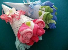 DIY Doily Bouquet - as a baby shower gift roll up various baby towels or onesies then wrap with dolie or lace like fabric. For bridal shower roll up various panties.  G;)