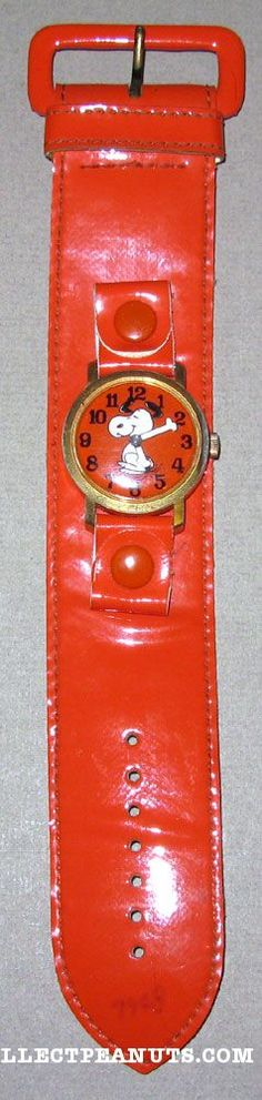 Original Determined Productions, Inc., orange dancing Snoopy watch on original orange band, large size