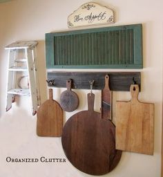 a rustic farmhouse style kitchen wall, home decor, kitchen design, repurposing upcycling, This display can be put together economically with a thrifted step stool or step ladder and cutting boards