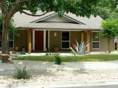 Ranch Redo, We updated our 1960s ranch. Took down the shutters and dying holly bushes, painted the brick, enlarged the patio, changed the posts, re-routed the walkway, changed the lights, added house numbers, side fences, retaining walls, and rock beds., almost there - hadnt painted door, hung numbers, or found right pot for plants       , Home Exterior        Design