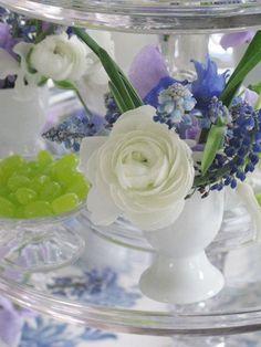 Miniature arrangement of ranunculus, delphinium, hyacinth, sweet pea and muscari