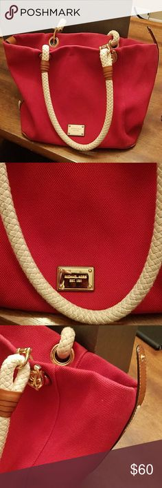 Michael Kors Large Red Canvas Bag Beautiful! Michael Kors Red Canvas Bag with Beautiful Cream Rope Straps with Brown Leather Accents. Excellent Overall Condition Minor Signs of Normal Wear Michael Kors Bags