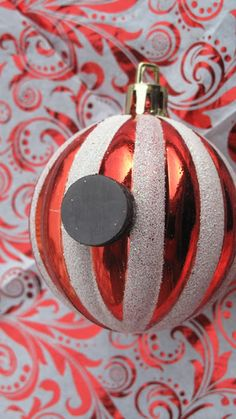 Red Couch Recipes: Christmas Ornament Refrigerator Magnets-Just get a variety of Christmas ornaments, then glue a button magnet on each with a strong adhesive such as E-6000. And… Ta-daa!! Your collection will make 3-D decorative arrangement on a file cabinet, a refrigerator or any other metal surface!
