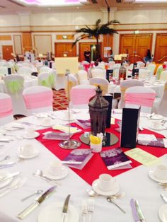 chair cover and sash hire birmingham plastic stackable chairs beautiful white covers with coral orange organza sashes hilton metropole midland mandaps ltd