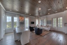 This open air living/dining room is perfect for dinner parties and entertaining.  http://chimarconstruction.com/