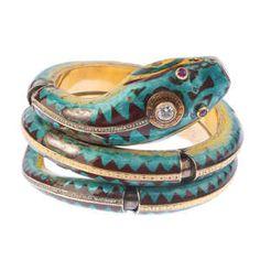 LOT:287 | A diamond, ruby and enamel snake bangle.