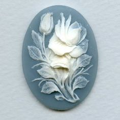 Google Image Result for http://vintagejewelrysupplies.com/2655-6404-large/cameo-white-rose-on-blue-background-40x30mm-.jpg