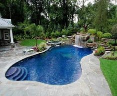 Backyard pool -- Love the waterfall & tiles or the color of water. Now just need it to be salt water & I'm good to go!!