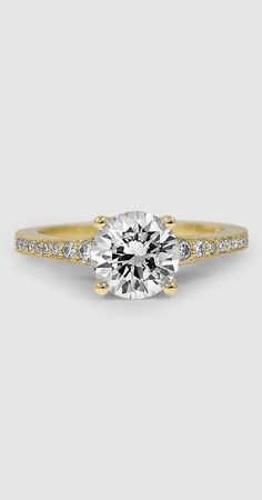 Milgrain detailing adds a vintage touch to this romantic ring