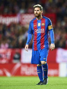 Lionel Messi of FC Barcelona looks on during the match between Sevilla FC vs FC Barcelona as part of La Liga at Ramon Sanchez Pizjuan Stadium on November 6, 2016 in Seville, Spain.