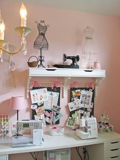 Someday I will have time to sew again and I'll have a pink and white craft room like this!  With a touch of green of course.