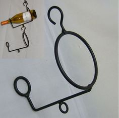 "Extendable Wrought Iron Wine Bottle Hanger  These hook onto each other to hang multiple wine bottles!  Just screw an eye hook in for support. Measurements: 8"" High X 7"" Wide  Hand-crafted, High Quality Wrought Iron Made in America!  http://www.outerbankscountrystore.com/servlet/the-1439/Made-in-the-USA/Detail"