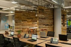 Workstations in the foreground, and looks like collaborative space in the background. Love the wood texture. Kiva Office Design by Studio Architecture