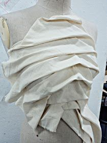 One more nice way of how to get ideas straight onto the stand - draping the fabric, pinning it on the stand and getting the ideas which late...