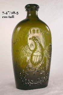 A variation of the American eagle were the quite artistic versions found on the flasks produced by several Connecticut glass factories.  This pint flask is a product of the Willington Glass Company of West Willington, CN. and is so embossed on the reverse.