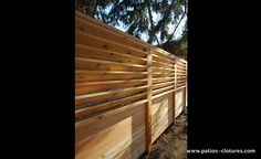 A horizontal palisade fence with fixed horizontal louvers that we builtfor Mr. Pinet in Montreal in the borough of Anjou.