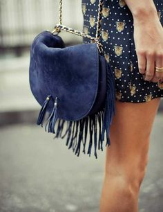 Elevate your effortlessly chic look with a fringe leather or suede bag!