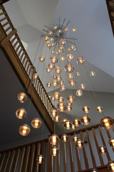 A stunning custom Bocci 14.81 chandelier with spreader bars