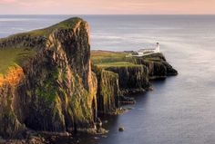 size: Photographic Print: Neist Point and Lighthouse Bathed in Evening Light, Isle of Skye, Highland by Lee Frost : Oahu, Highlands, Algarve, Bora Bora, Find Art, Framed Artwork, Valencia, Lighthouse, Beautiful Places