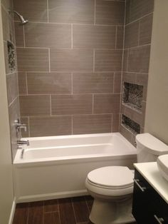 """30x36 shower created a 10x5 space. shallow vanity. challenge a normal size tub (32 x 60) that was deep enough. I also tend to mix modern with warm wall color that was neutral & floor tiles w/ a rustic flair. I could accent with more """"fun"""" tub tile: daltile fabrique in linen Floor: exotica walnut Mosaic: elegant azules Vanity: virtu Augustine Tub: Kohler archer Daltile Fabrique Gris tiles, I designed custom niches with mosaic wood-style tile on the floor to balance the modern,"""