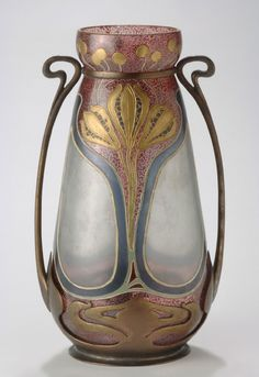 Vase on Brass Mount Artist/maker unknown, American Geography: Made in United States, North and Central America Date: 1910 Medium: Glass with brass mount Dimensions: Height: 10 1/2 inches (26.7 cm