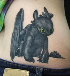 How to Train Your Dragon tattoo of Toothless. Love it. Links to an article full of tattoos from children's films.