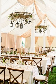 Woodland wedding. Enchanted forest. 15 Gorgeous Ways to Decorate Your Wedding Tent via Brit + Co