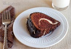 Chocolate Bundt Cake with a Cream Cheese Swirl - via Barbara Bakes: Adventures in the Kitchen. A moist, chocolate sour cream bundt cake covered in a rich chocolate ganache with a luscious cream cheese swirl hiding inside. Sweet Recipes, Cake Recipes, Dessert Recipes, Healthy Chocolate, Chocolate Recipes, Just Desserts, Delicious Desserts, Greek Desserts, Chocolate Bundt Cake