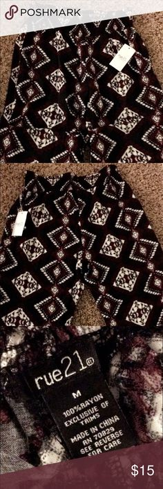 Clothes/pants These are tribal print pants that's are 100% rayon exclusive of trims and it's made in China. Rue 21 Pants