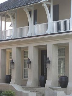 CURB APPEAL – another great example of beautiful design. Lanterns and stucco exterior.
