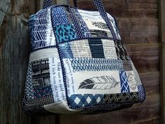 Quilted Weekender Bag by Laura @ Needles, Pins and Baking Tins, via Flickr  more tip and tricks to make the bag