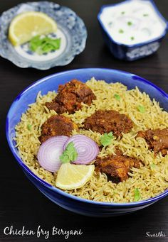 chicken fry biryani - andhra restaurant style dum cooked biryani rice with spicy chicken fry. It is served with salan & onion raita