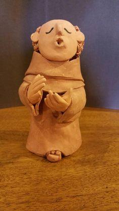 Check out this item in my Etsy shop https://www.etsy.com/listing/253118521/original-taos-folk-art-clay-storyteller