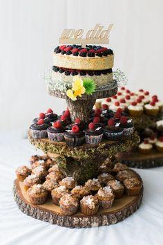 Rustic wedding dessert display - tree slice display wtih assorted cupcakes and fruit tart {Dina Remi Studios}
