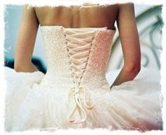 Poofy wedding dress with a corset back<3 I want my wedding dress like this one .