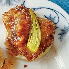 Chicken Biscuit... this one looks heavenly with some of those pickled veggies and spicy peachy preserves