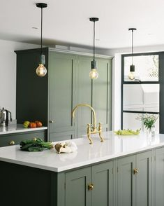This Shaker kitchen t has been painted in a bespoke shade, a beautiful dark olive that works so well with the aged brass hardware and tap. The three hanging pendant bulbs are a cool addition and add a modern touch to this space. Green Kitchen Cabinets, Kitchen Cabinet Colors, Kitchen Colors, Kitchen Colour Schemes, Kitchen Brass Hardware, Green Kitchen Island, Kitchen Islands, Kitchen Cart, Color Schemes