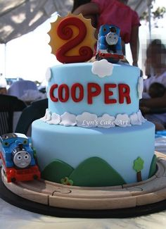 LOVE the train track around the base of the cake!! doesn't have to be Thomas!