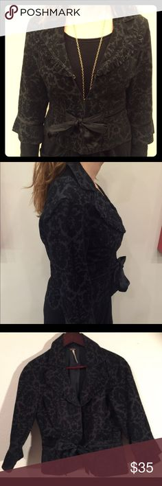 FREE PEOPLE black courdory jacket Size 6 FREE PEOPLE black courdory jacket Size 6. Silk tie at bust. 3/4 sleeves. Perfect condition! Free People Jackets & Coats Blazers