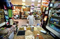 A Kuwaiti citizen shops for nuts at a stall at a market in Kuwait City on July 30, 2012, during Islam's holy month of Ramadan, when Mulsims the world over fast from dawn to dusk.